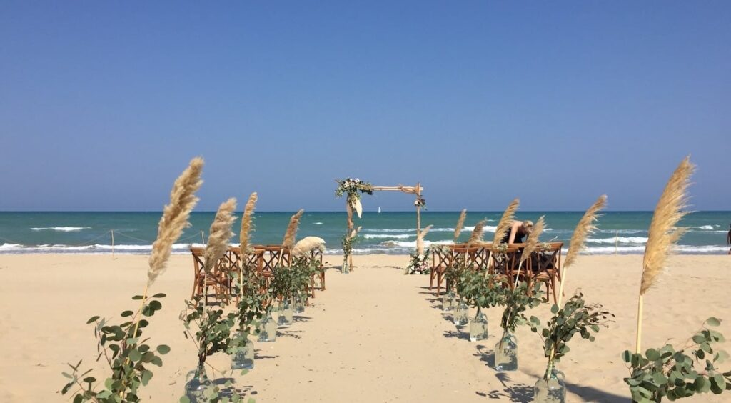 Beach wedding ceremony pampas flowers Abruzzo Italy