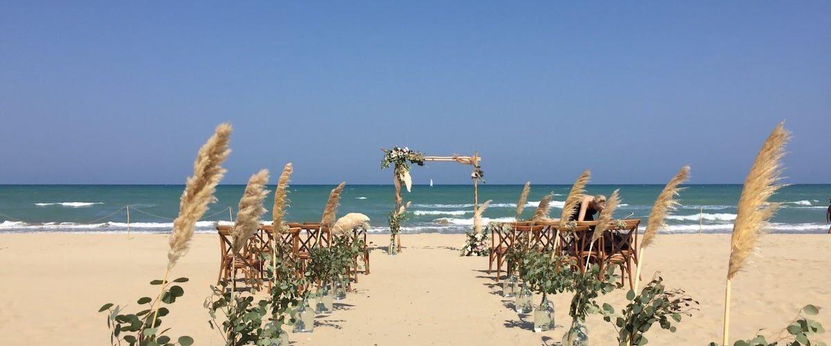 Beach wedding ceremony pampas flowers Abruzzo Italy