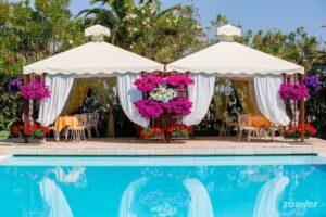 poolside gazebos flowers luxury wedding Mion Abruzzo Italy