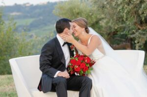 Luxury red rose bridal bouquet created for a vineyard wedding in the Abruzzo Region of Italy.
