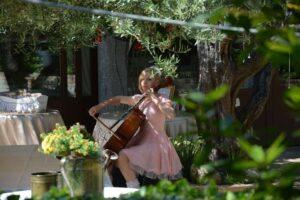 cellist playing music garden sunshine wedding venue