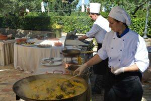Italian chefs cooking risotto in garden wedding venue