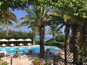 Swimming pool palm trees luxury beach wedding venue Italy