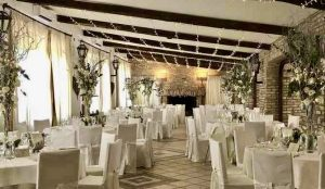 Dining room white wedding flowers Italian wedding venue