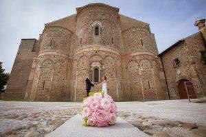 Facade ancient abbey wedding couple San Giovanni in Venere