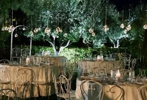 wedding dining tables hanging candles garden venue