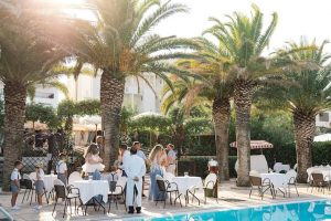 guests at poolside buffet beach wedding venue Italy