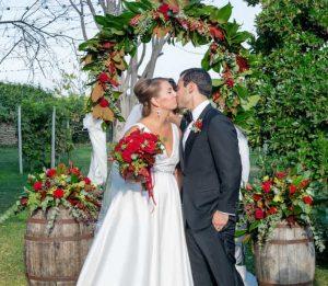 bride groom red flowers legal marriage ceremony vineyard Italy