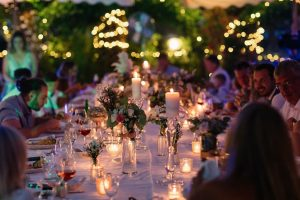 Candles flowers lights decorated table wedding venue