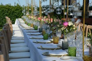 Luxury design for vineyard wedding in Abruzzo, bespoke flower design and candles at Castello di Semivicoli