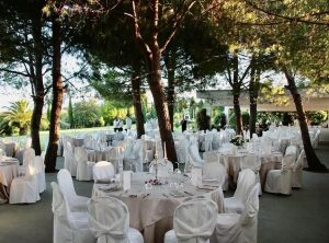 Italy wedding dining tables under pines palm trees