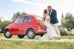 wedding couple red fiat500 wedding car vineyard Italy