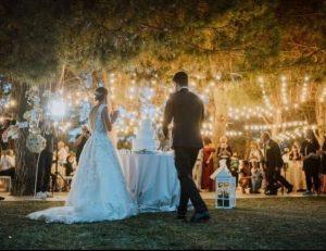 couple with wedding cake garden wedding venue Italy