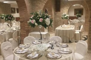 Tall floral centrepieces wedding tables Castello di Septe Italy