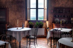 tables in antique castle view of Italian countryside rural wedding venue