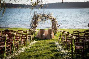 Rustic country lakeside wedding ceremony and reception Casale Martignano Lake Martignano Umbria
